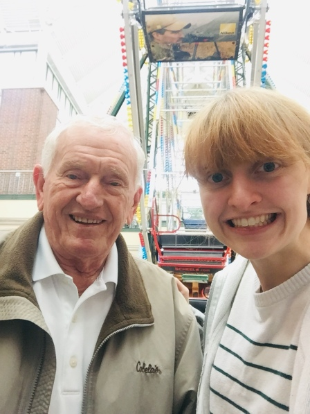 Image of me and my grandpa beside a ferris wheel